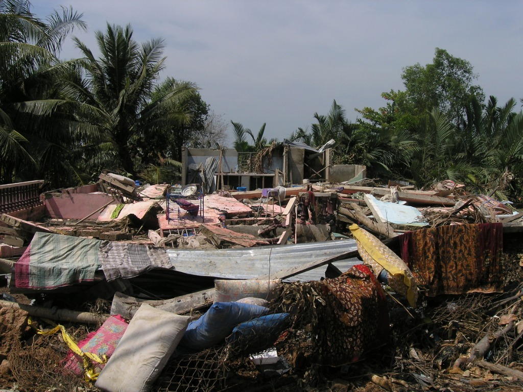 Collapsed wooden housing  after natural disaster